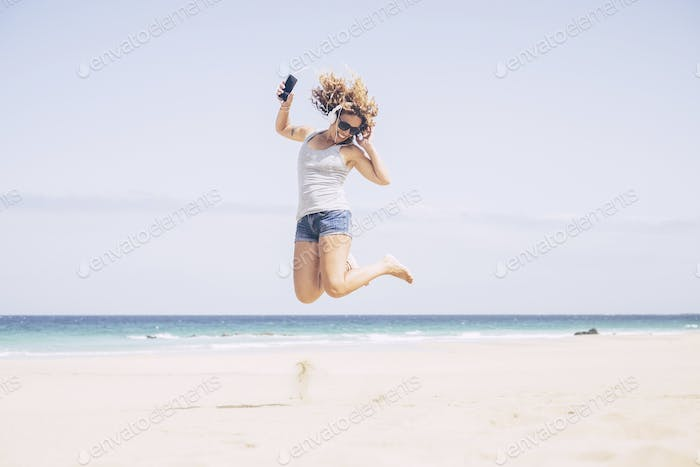 cheerful and attractive caucasian young woman enjoy the summer beach