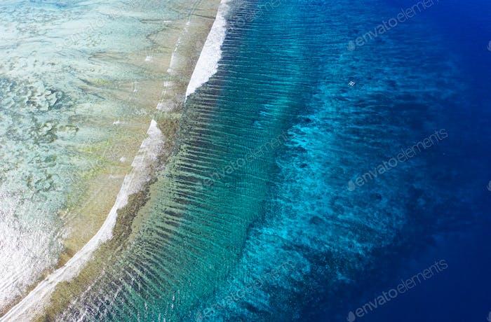 Reef and sea, Gili Meno island, Indonesia. Aerial seascape