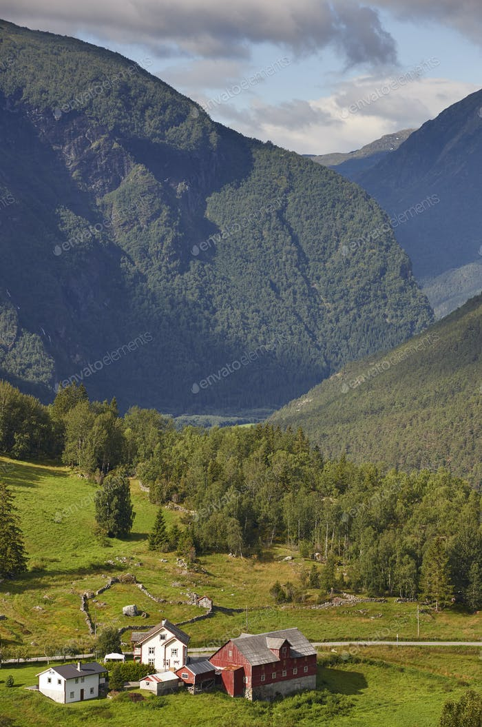 Traditional norwegian mountain landscape with old wooden houses. Travel Norway