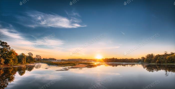 Panorama Of Autumn River Landscape In Europe At Sunrise. Sun Shi