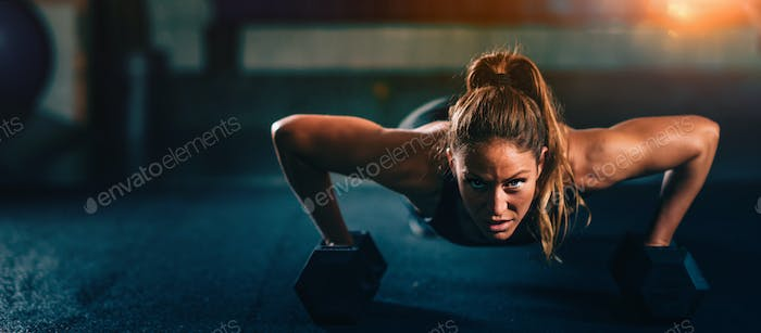 Cross training. Young woman exercising at the gym