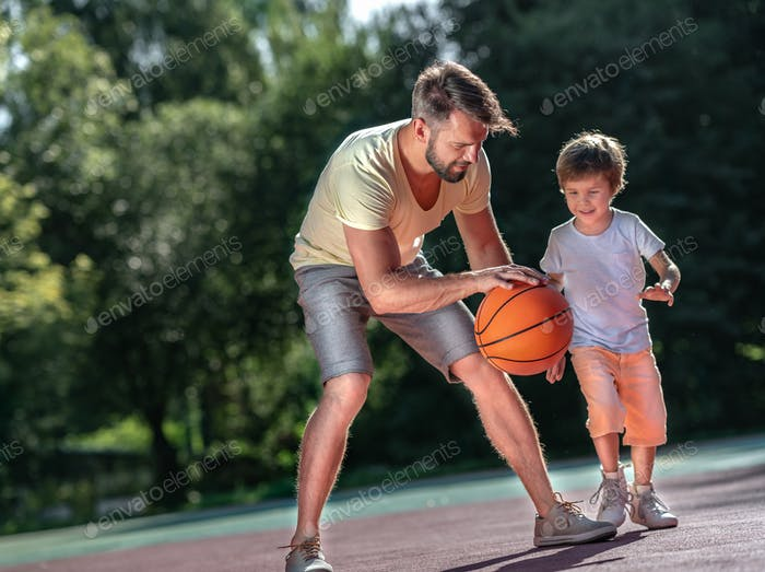Family playing basketball outdoors