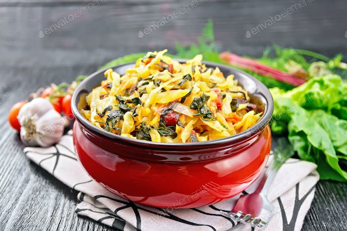 Cabbage stew with chard in bowl on board