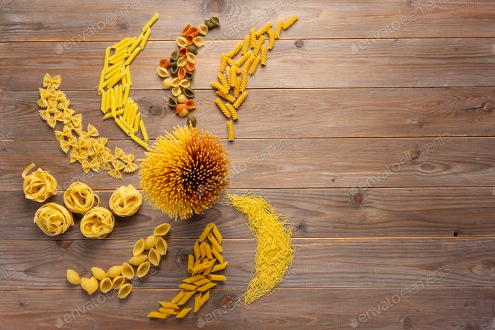 Pasta collection food on wooden table background. Raw pasta italian food