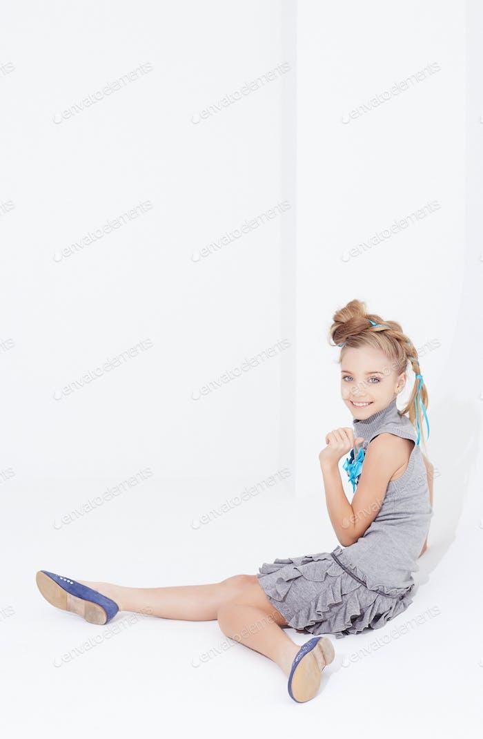 Cute little girl in grey dress.