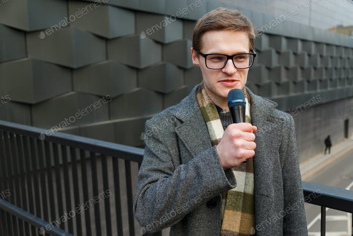 Professional news reporter outdoor