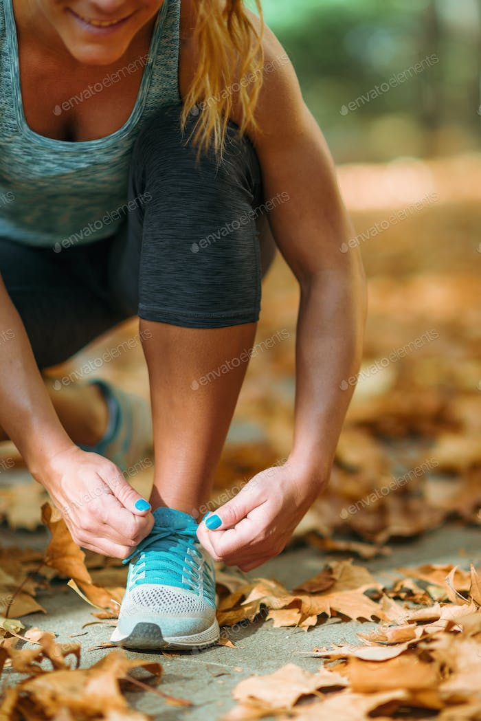 Woman Exercising Outdoors in The Fall
