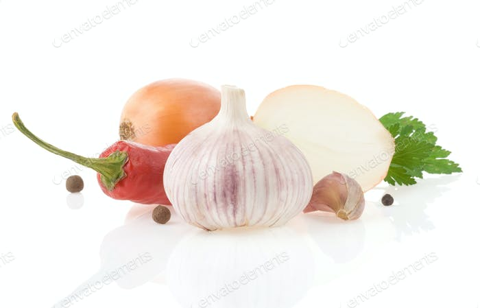 garlic and vegetables with food spices isolated on white