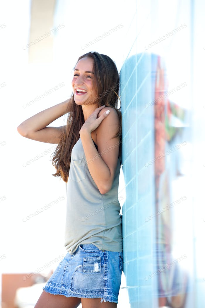 Carefree young woman standing outside