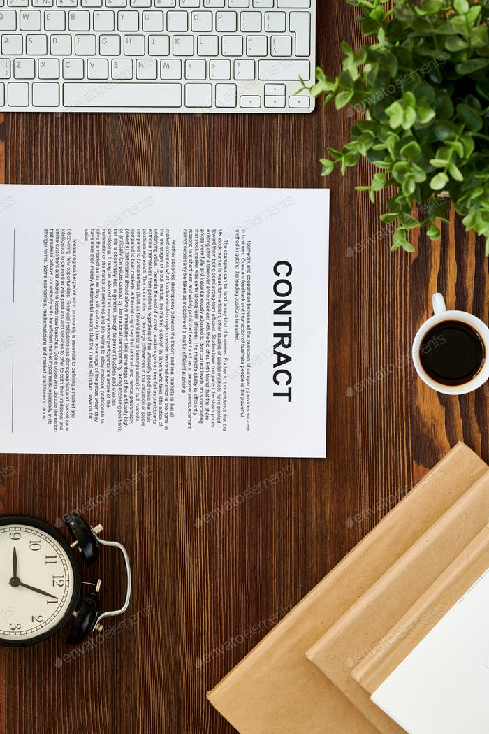 Contract on Wooden Table