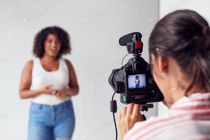 Female Videographer Recording Woman Recording Podcast In Studio