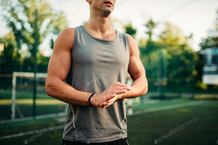 Muscular male athlete on training, fitness workout