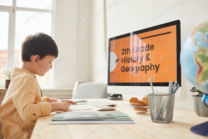 Little Boy Studying in Online School
