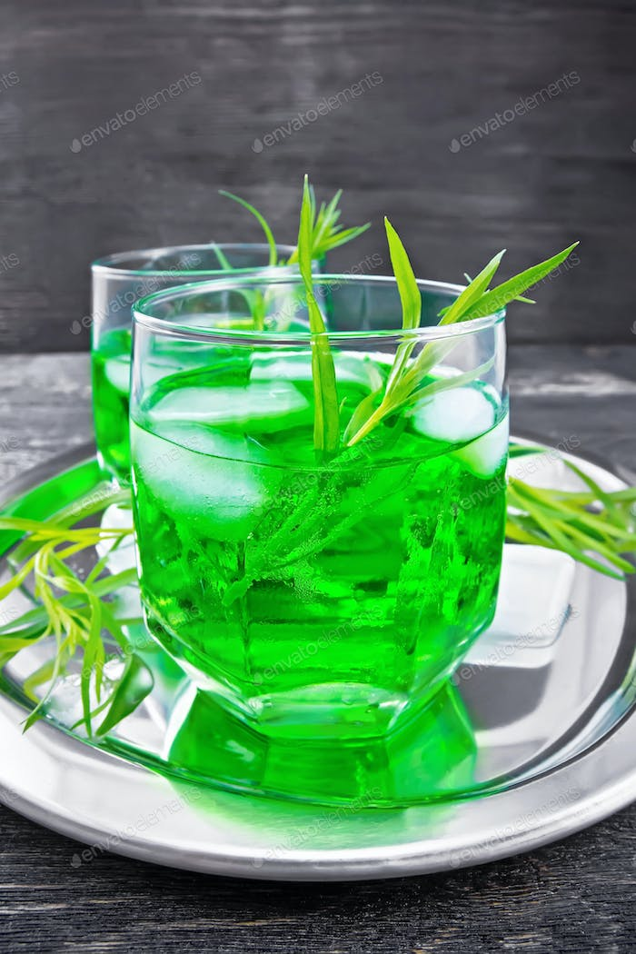 Lemonade Tarragon with ice in two glasses on board