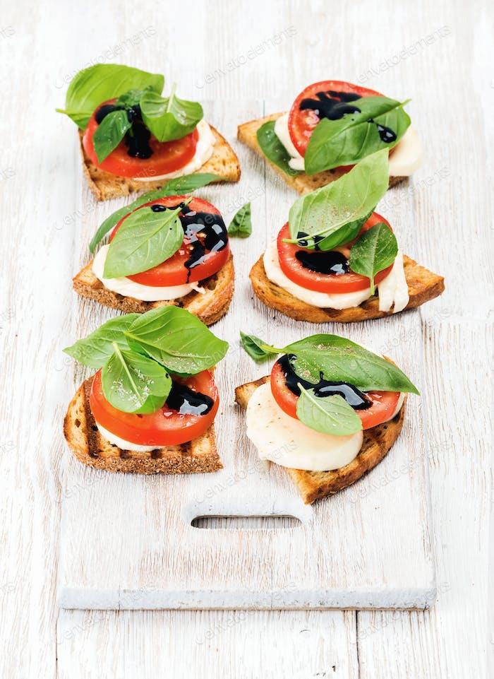 Caprese sandwiches with tomato, mozzarella cheese, basil and balsamic glaze
