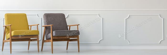 Two armchairs in empty room