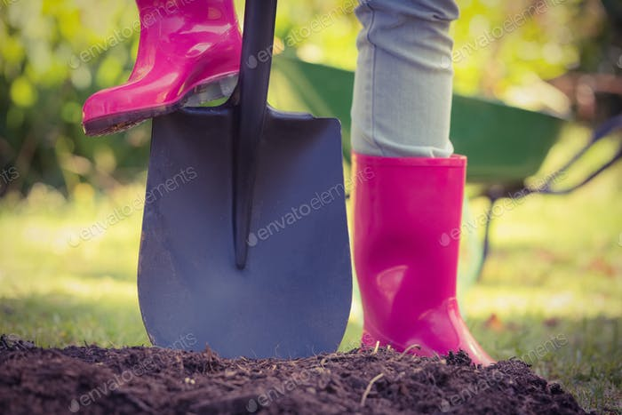 Woman holding shovel in the garden