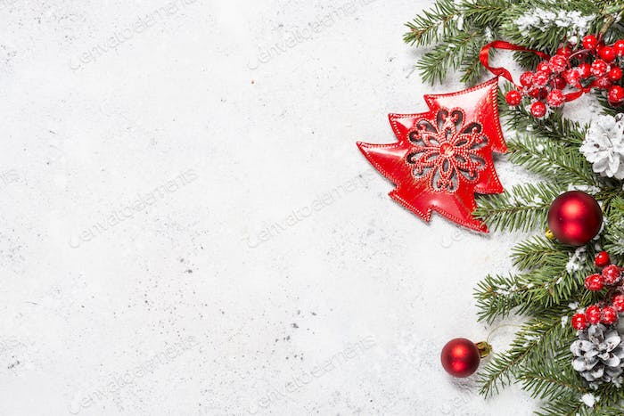 Christmas background with fir tree and decorations on white back