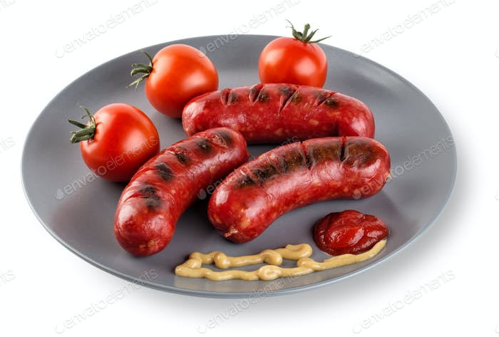Fried sausages with tomatoes mustard and ketchup on plate