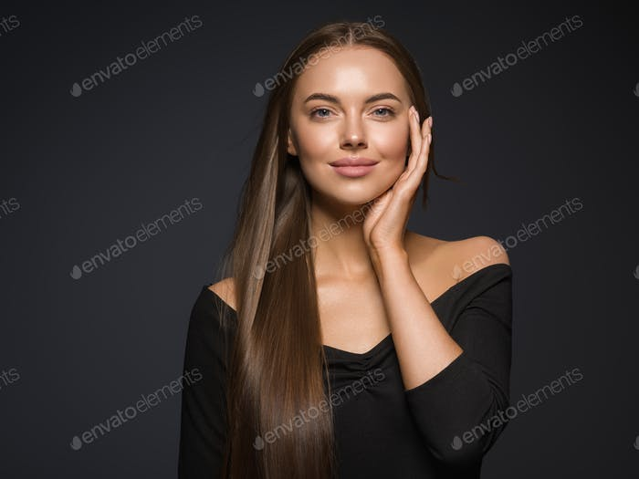 Smooth beauty woman long hair brunette female model natural makeup beautiful girl dark background