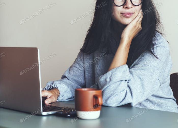 Woman working on a laptop in her home