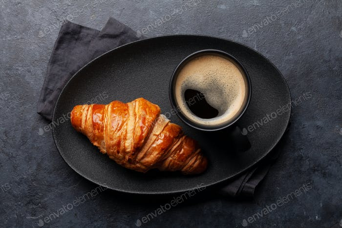 Espresso coffee and croissant for breakfast