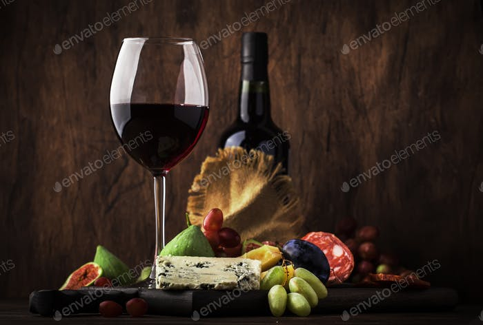 Red wine glass and appetizers