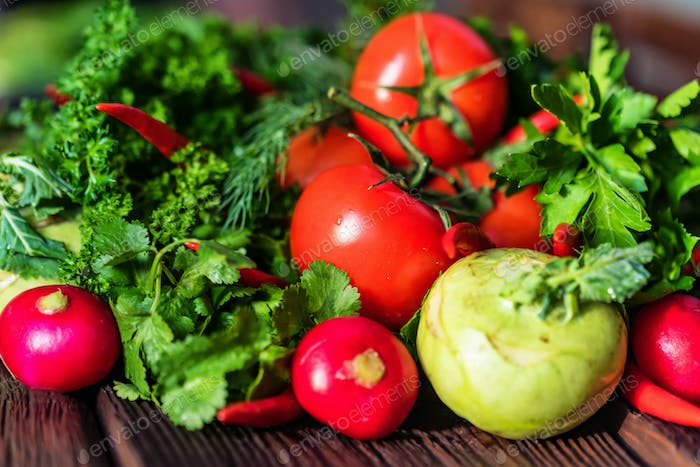 Fresh vegetables and herbs on wooden table