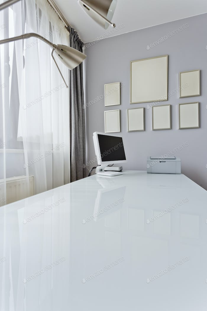 White desk top with computer