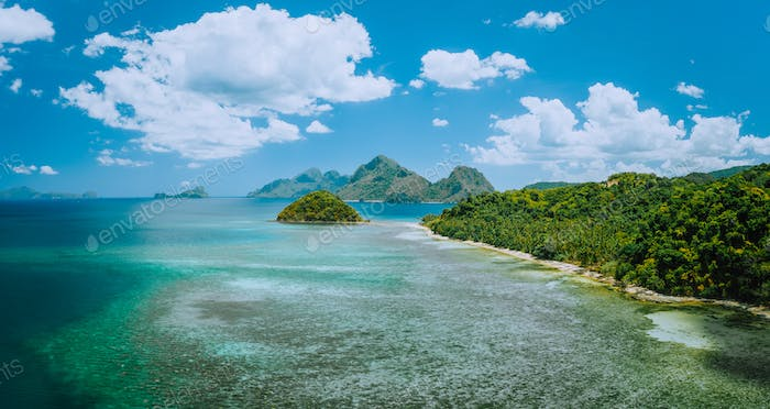Aerial panoramic view of coastline with Las Cabanas beach in El Nido, Palawan, Philippines