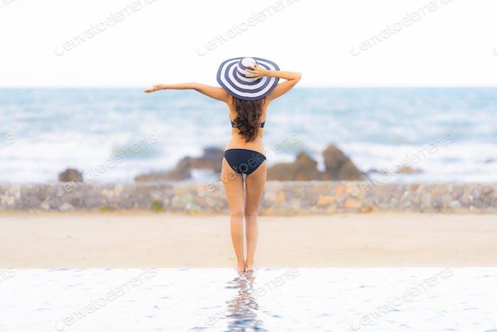 Portrait beautiful young asian woman wear bikini around swimming