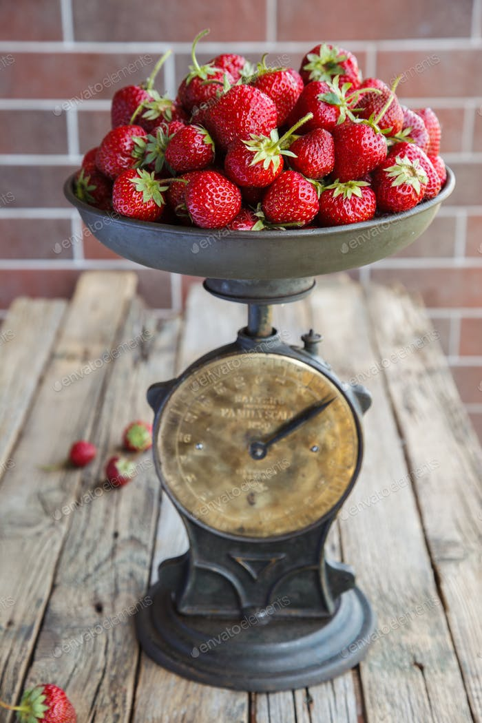 Vintage scales with fresh strawberries.Vintage style.