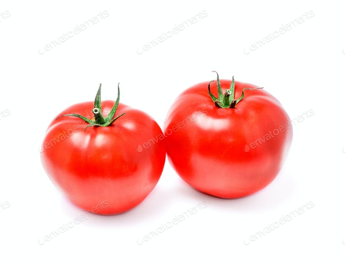 Two ripe tomatoes closeup on a white