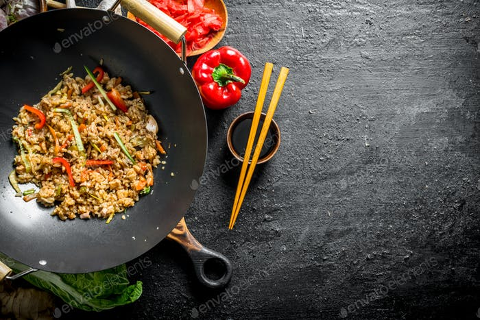 Chinese wok. Asian rice with beef in a wok pan.