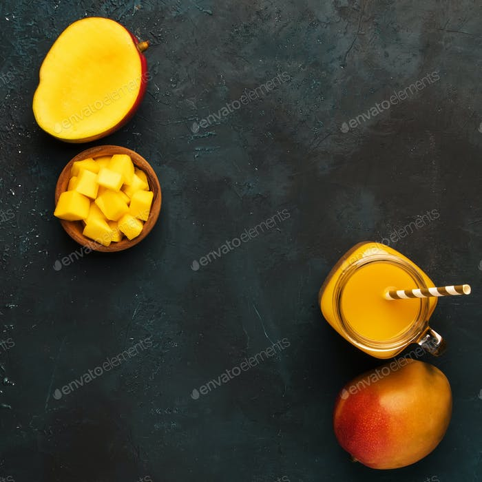 Mango smoothie in glass jar with fresh fruit