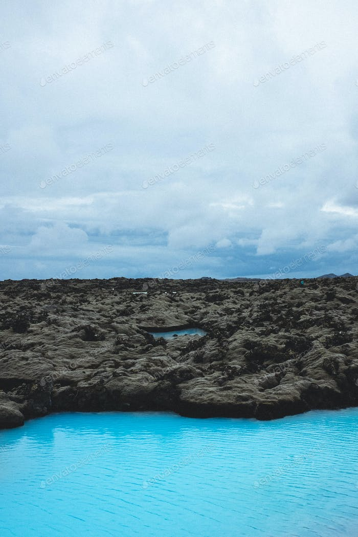 Blue lagoon in a lava moss field