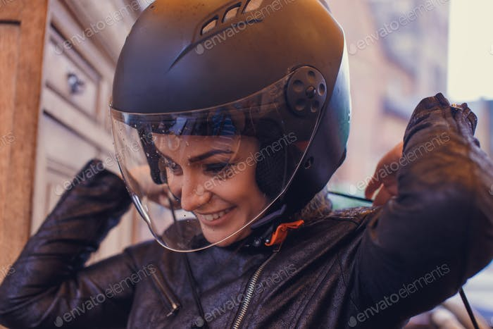 A woman wearing a moto helmet.