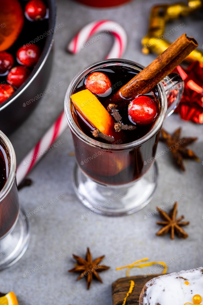 Serving Mulled Wine on Festive Decorated Christmas Table