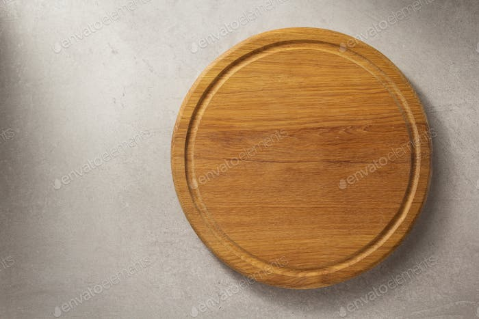 pizza cutting board at grey stone table