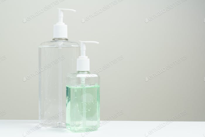 Two hand sanitizer in plastic bottle on white background