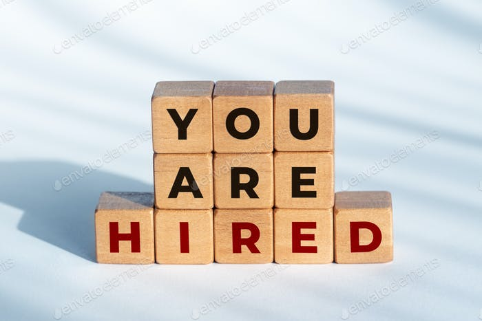 You are Hired phrase on wooden blocks