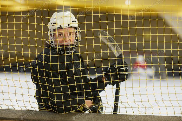 Female Hockey Player Smiling