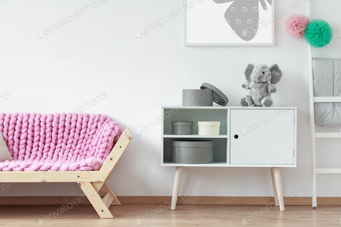 Sofa with pink blanket