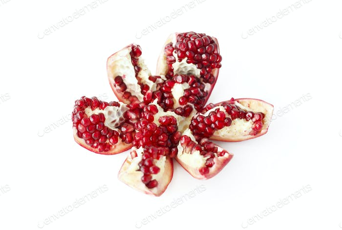 Cut pomegranate fruit on white background