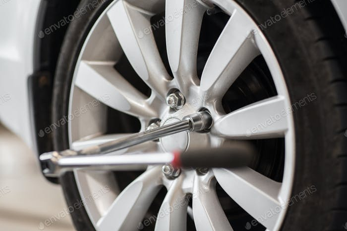 screwdriver and car wheel tire