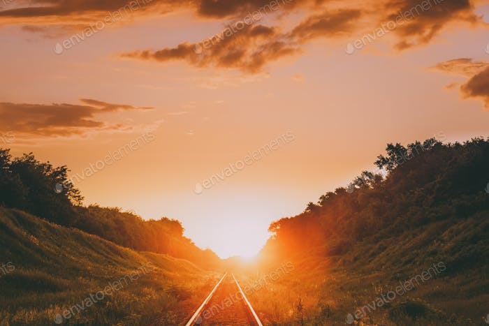 Railway In Dramatic Sunset Backlight. Scenic View Of Railway Goi