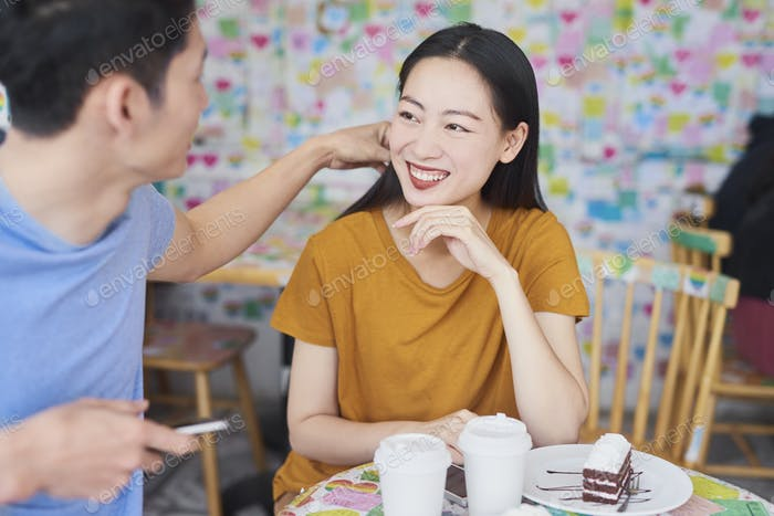 Young couple having happy time in a cafe