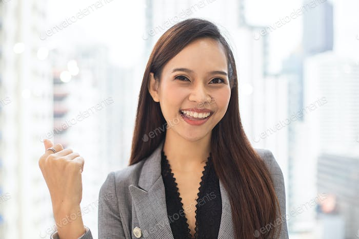 Portrait of success Asian businesswoman smiling in the office