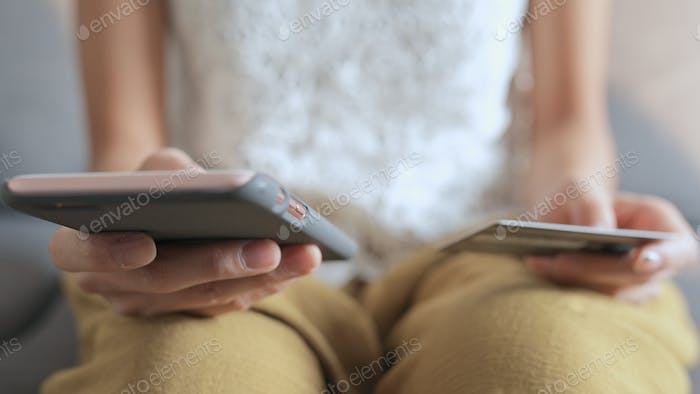 Woman using cellphone for online shopping