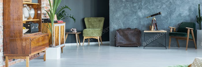 Grey room with green armchair